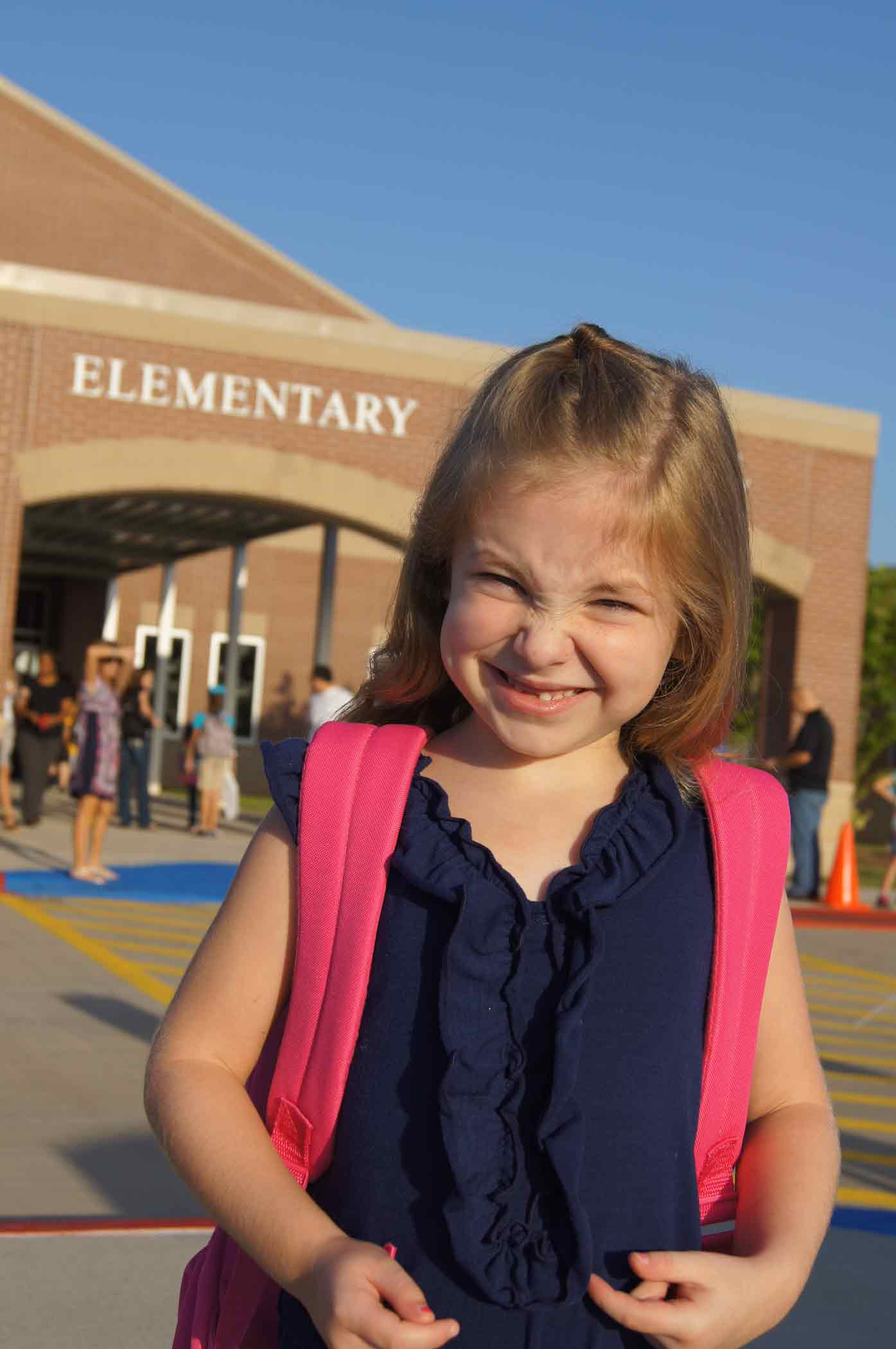 Happy outside the school on her first day of kindergarten. Waterworks were soon to follow.